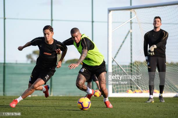 Yoshinori Muto and Kenedy jostle for the ball as Goalkeeper Karl Darlow looks on during the Newcastle United warm weather training session at La...