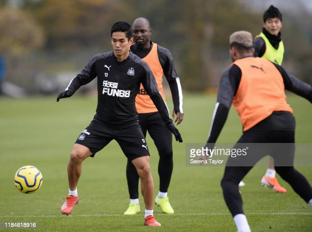 Yoshinori Muto controls the ball during the Newcastle United Training Session at the Newcastle United Training Centre on October 31, 2019 in...