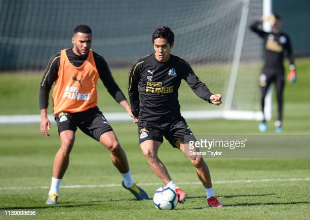 Yoshinori Muto controls the ball whilst Jamaal Lascelles looks to challenge during the Newcastle United Training session at the Newcastle United...