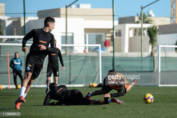 Yoshinori Muto falls to the ground after a challenge by Isaac Hayden during the Newcastle United Warm Weather Training Campat La Finca Golf Resort on...