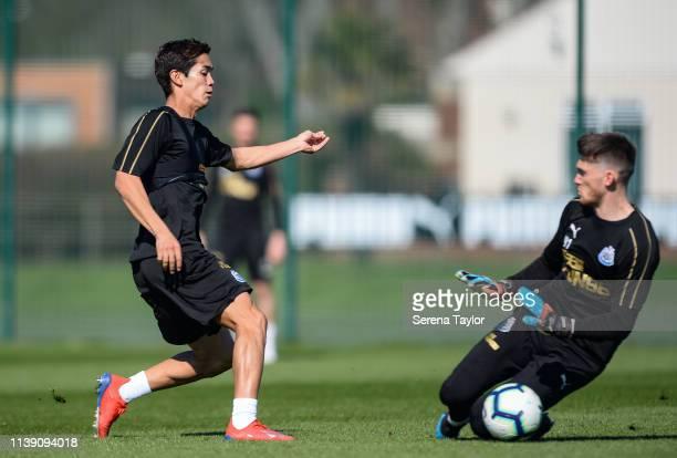 Yoshinori Muto has his strike saved by Goalkeeper Freddie Woodman during the Newcastle United Training session at the Newcastle United Training...