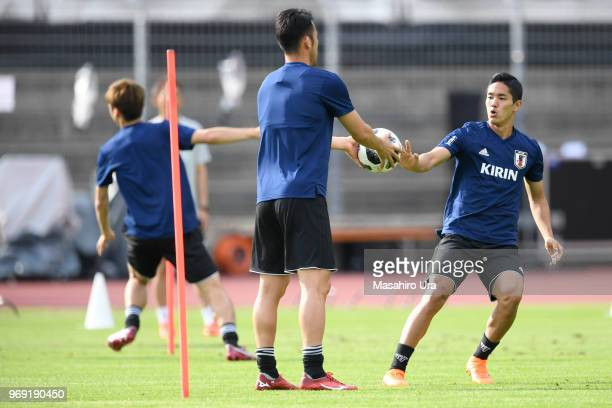 Yoshinori Muto in action during a training session ahead of the international friendly match against Switzerland at the Stadium Cornaredo on June 7...