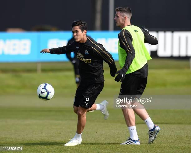 Yoshinori Muto intercepts the ball from Ciaran Clark during the Newcastle United Training Session at Newcastle United Training Centre on April 17...