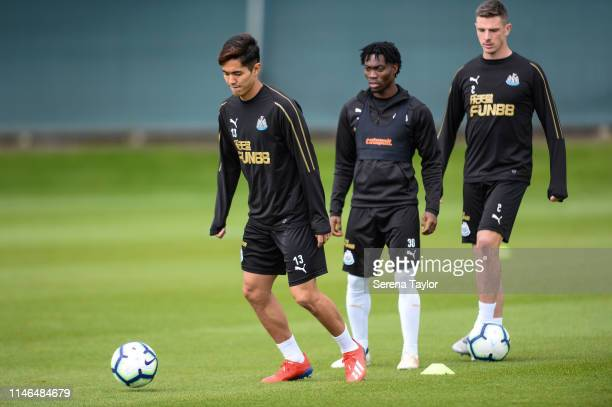 Yoshinori Muto looks to pass the ball during the Newcastle United Training Session at the Newcastle United Training Centre on May 02 2019 in...