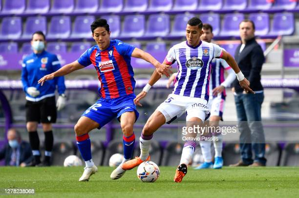 Yoshinori Muto of Eibar battles for possession with Luismi of Real Valladolid during the La Liga Santander match between Real Valladolid CF and SD...