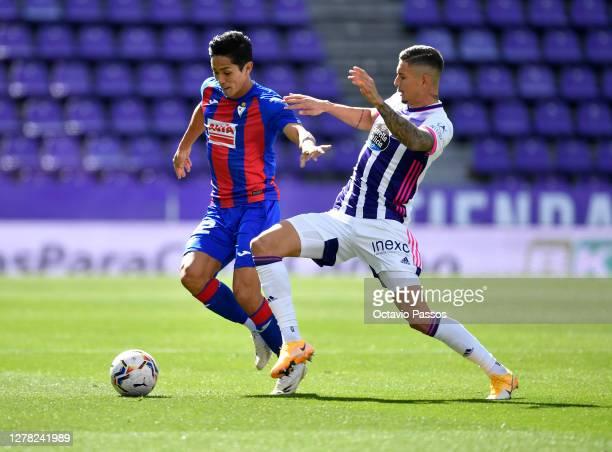 Yoshinori Muto of Eibar is challenged by Javi Sanchez of Real Valladolid during the La Liga Santander match between Real Valladolid CF and SD Eibar...