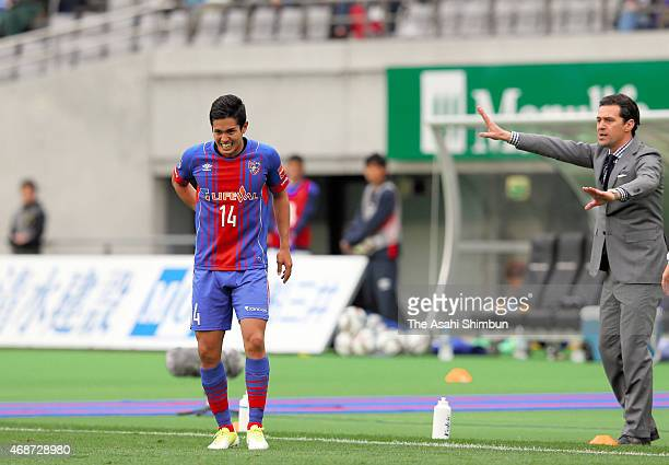 Yoshinori Muto of FC Tokyo is replaced after getting a back injury during the JLeague match between FC Tokyo and Ventforet Kofu at Ajinomoto Stadium...