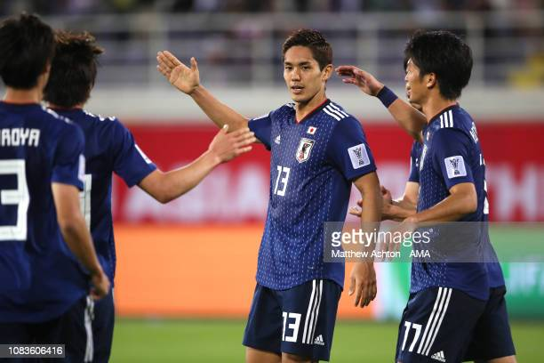 Yoshinori Muto of Japan celebrates scoring a goal to make it 1-1 during the AFC Asian Cup Group F match between Japan and Uzbekistsn at Khalifa Bin...