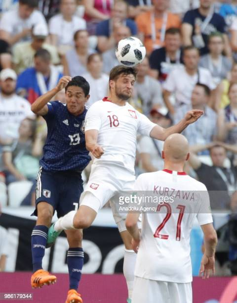 Yoshinori Muto of Japan in action against Bartosz Bereszynski of Poland during the 2018 FIFA World Cup Russia Group H match between Japan and Poland...