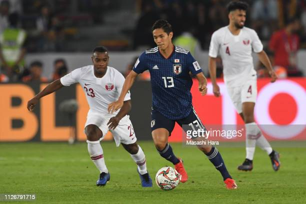 Yoshinori Muto of Japan in action during the AFC Asian Cup final match between Japan and Qatar at Zayed Sports City Stadium on February 01 2019 in...