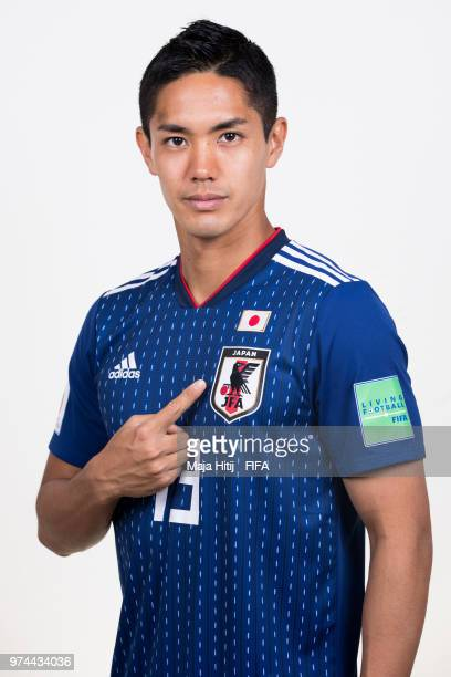 Yoshinori Muto of Japan poses for a portrait during the official FIFA World Cup 2018 portrait session at the FC Rubin Training Grounds on June 14...