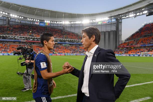Yoshinori Muto of Japan shakes hands with Akira Nishino Manager of Japan after the 2018 FIFA World Cup Russia group H match between Japan and Senegal...