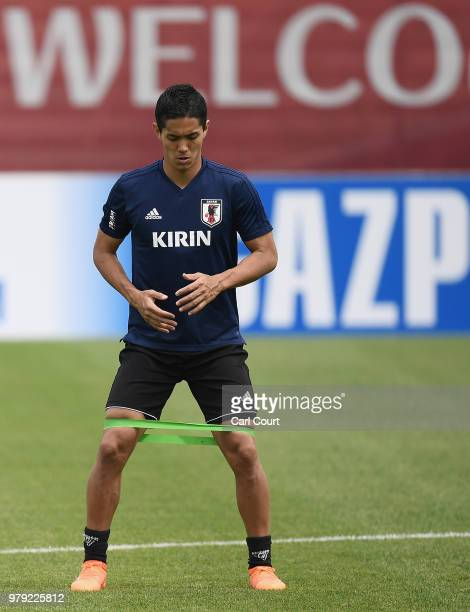 Yoshinori Muto of Japan stretches during a Japan training session during the 2018 FIFA World Cup at the FC Rubin Training Ground on June 20 2018 in...