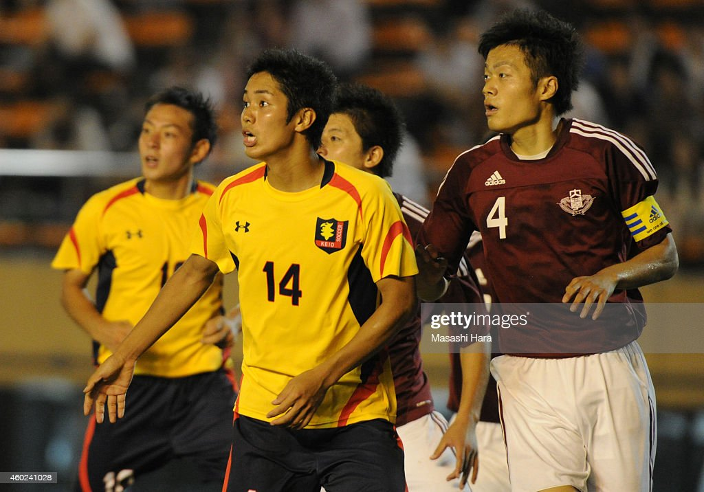 Yoshinori Muto (L) of Keio University in action during the match against Waseda University at the National Stadium on July 4, 2012 in Tokyo, Japan.