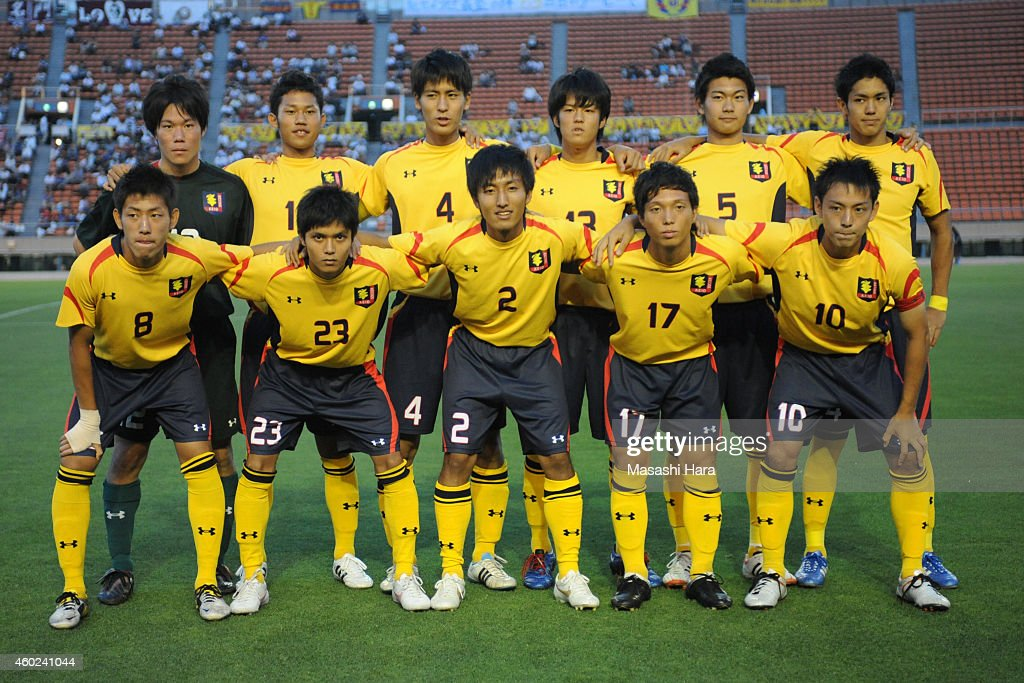Yoshinori Muto (1st R, back row) of Keio University lines up prior to the match against Waseda University at the National Stadium on July 4, 2012 in Tokyo, Japan.