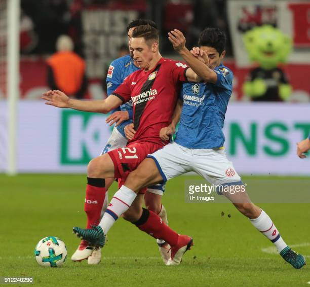 Yoshinori Muto of Mainz and Dominik Kohr of Leverkusen battle for the ball during the Bundesliga match between Bayer 04 Leverkusen and 1 FSV Mainz 05...