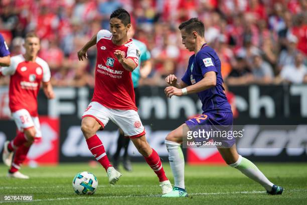 Yoshinori Muto of Mainz and Marco Friedl of Bremen in action during the Bundesliga match between 1 FSV Mainz 05 and SV Werder Bremen at Opel Arena on...