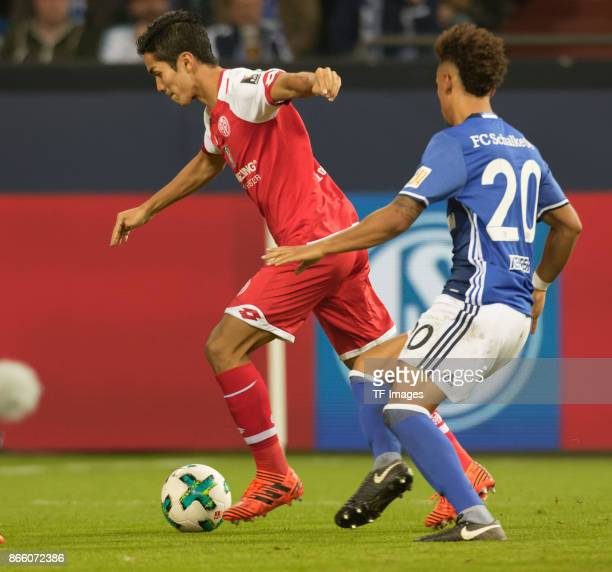 Yoshinori Muto of Mainz and Thilo Kehrer of Schalke battle for the ball during the Bundesliga match between FC Schalke 04 and 1 FSV Mainz 05 at...