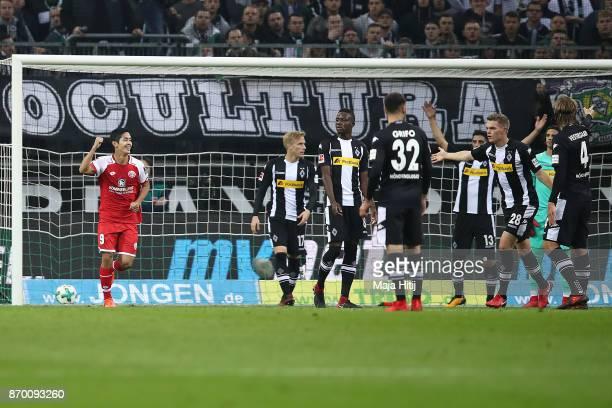 Yoshinori Muto of Mainz celebrates after Abdou Diallo of Mainz scored a goal to make it 01 during the Bundesliga match between Borussia...