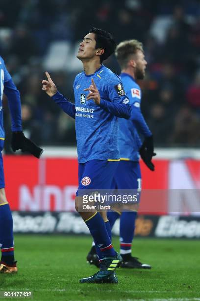 Yoshinori Muto of Mainz celebrates after scoring their first goal during the Bundesliga match between Hannover 96 and 1 FSV Mainz 05 at HDIArena on...