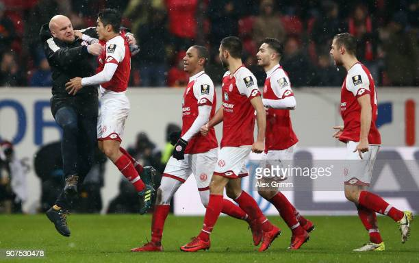 Yoshinori Muto of Mainz celebrates his team's first goal with sport director Rouven Schroeder during the Bundesliga match between 1 FSV Mainz 05 and...