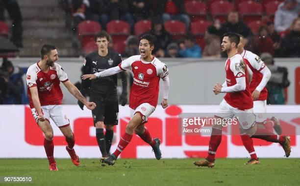 Yoshinori Muto of Mainz celebrates his team's first goal with team mates during the Bundesliga match between 1 FSV Mainz 05 and VfB Stuttgart at Opel...
