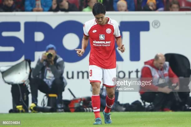 Yoshinori Muto of Mainz celebrates his team's second goal during the Bundesliga match between 1 FSV Mainz 05 and TSG 1899 Hoffenheim at Opel Arena on...