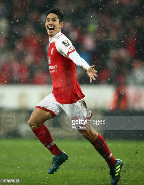 Yoshinori Muto of Mainz celebrates his team's second goal during the Bundesliga match between 1 FSV Mainz 05 and VfB Stuttgart at Opel Arena on...