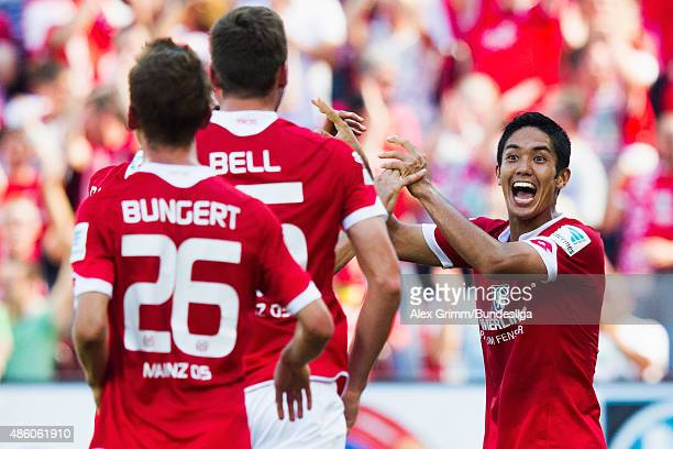 Yoshinori Muto of Mainz celebrates his team's second goal with team mates during the Bundesliga match between 1 FSV Mainz 05 and Hannover 96 at...
