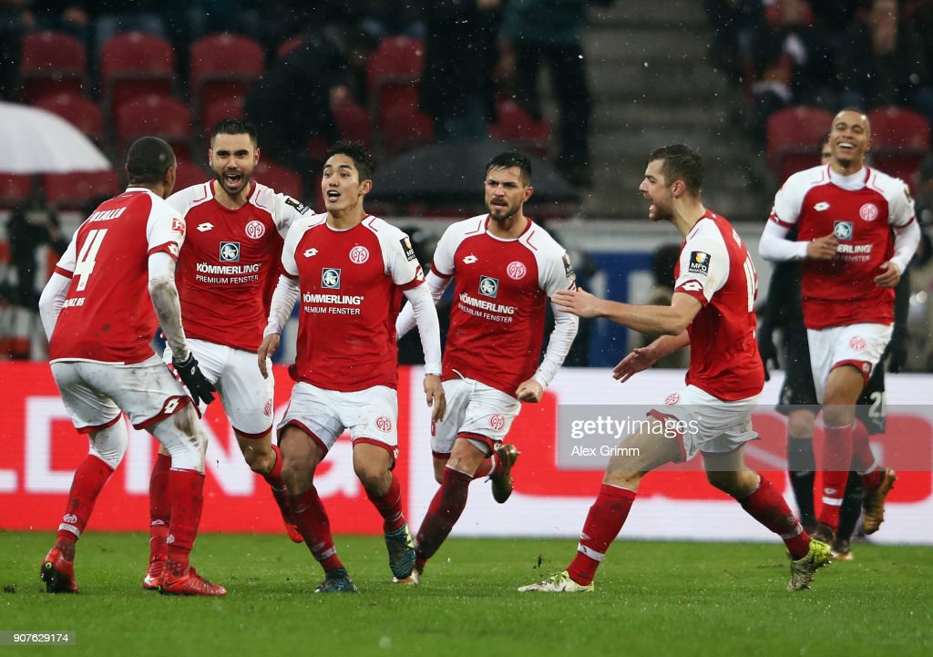 Yoshinori Muto (3L) of Mainz celebrates his team's second goal with team mates during the Bundesliga match between 1. FSV Mainz 05 and VfB Stuttgart at Opel Arena on January 20, 2018 in Mainz, Germany.