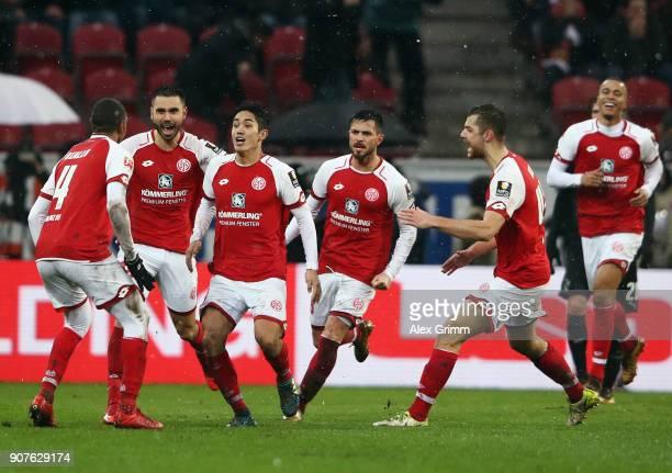 Yoshinori Muto of Mainz celebrates his team's second goal with team mates during the Bundesliga match between 1 FSV Mainz 05 and VfB Stuttgart at...