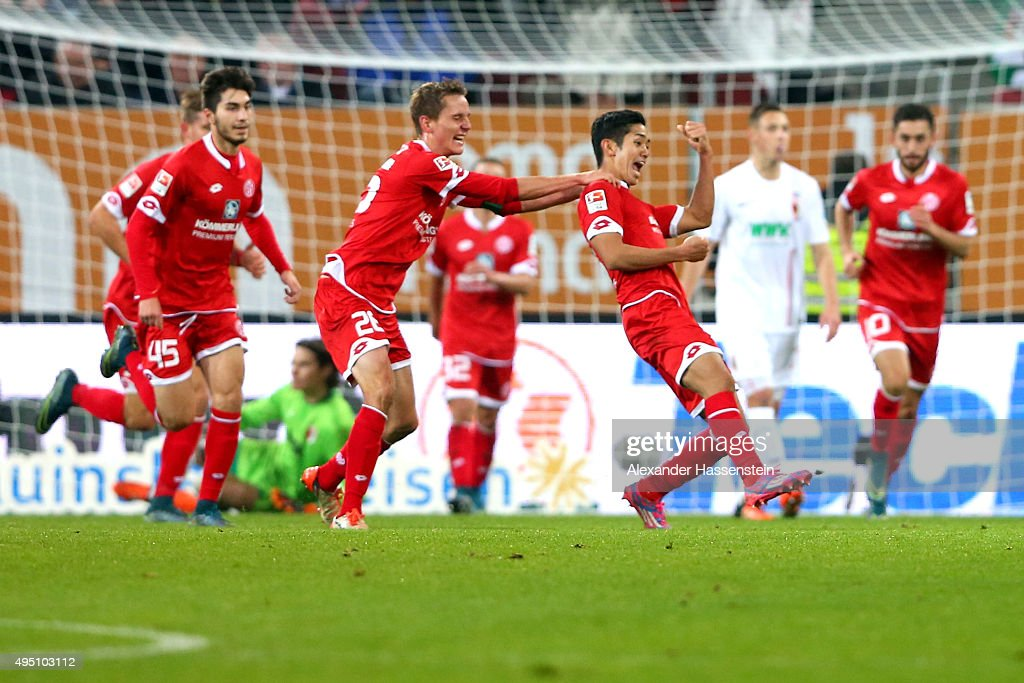 Yoshinori Muto (3rd R) of Mainz celebrates scoring the 3rd team goal during the Bundesliga match between FC Augsburg and 1. FSV Mainz 05 at WWK Arena on October 31, 2015 in Augsburg, Germany.