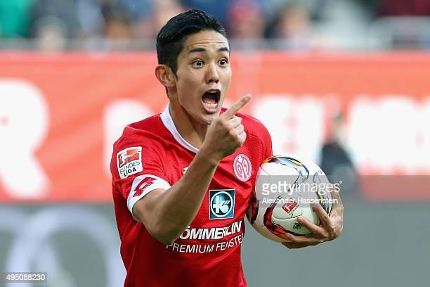Yoshinori Muto of Mainz celebrates scoring the opening goal during the Bundesliga match between FC Augsburg and 1 FSV Mainz 05 at WWK Arena on...