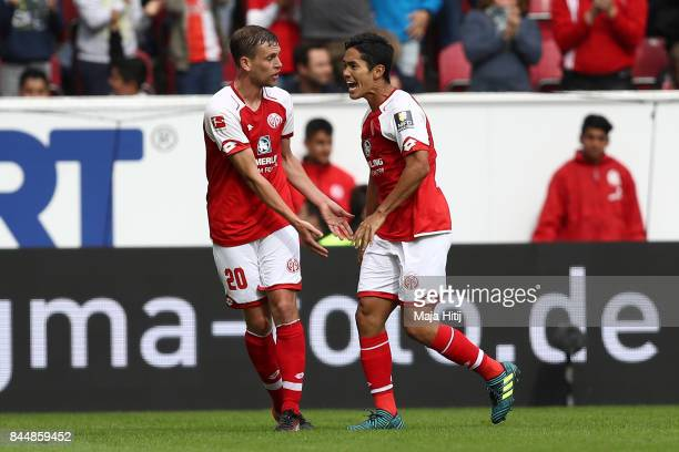 Yoshinori Muto of Mainz celebrates with Fabian Frei of Mainz after he scored his teams first goal to make it 11 during the Bundesliga match between 1...