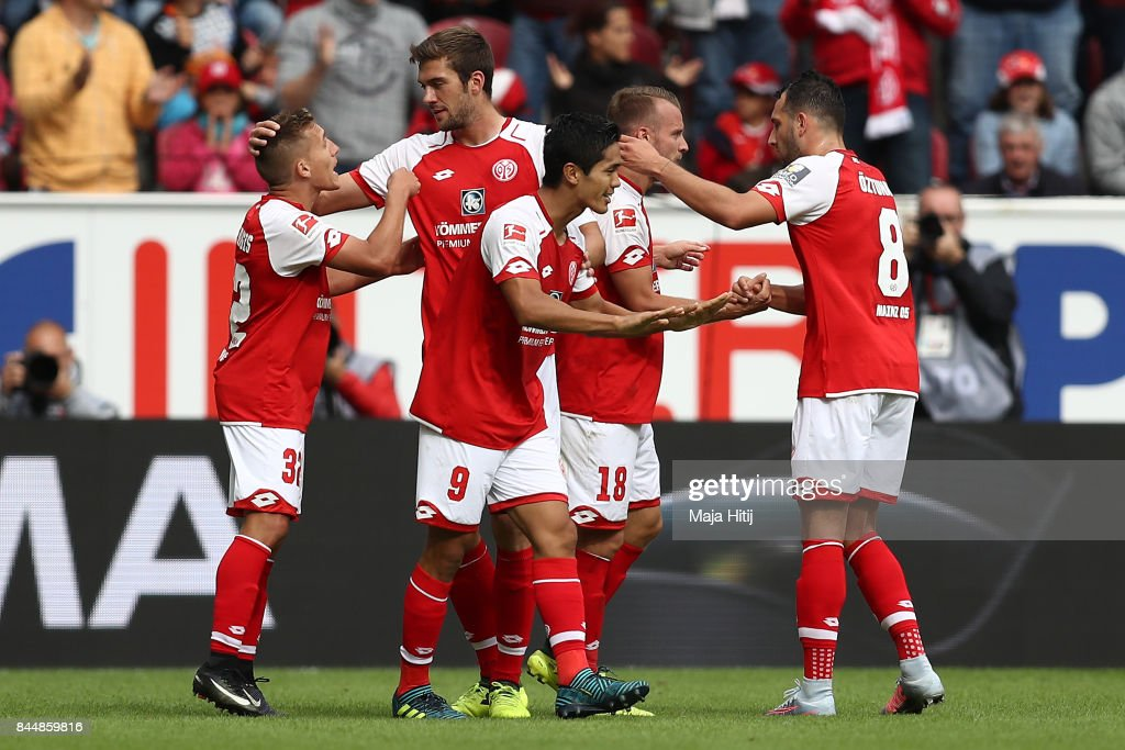 Yoshinori Muto of Mainz (r) celebrates with fellow players after he scored his teams first goal to make it 1:1 during the Bundesliga match between 1. FSV Mainz 05 and Bayer 04 Leverkusen at Opel Arena on September 9, 2017 in Mainz, Germany.