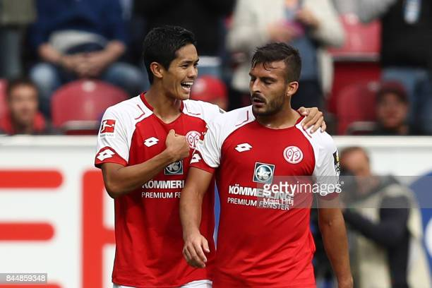 Yoshinori Muto of Mainz celebrates with Giulio Donati of Mainz after he scored his teams first goal to make it 11 during the Bundesliga match between...