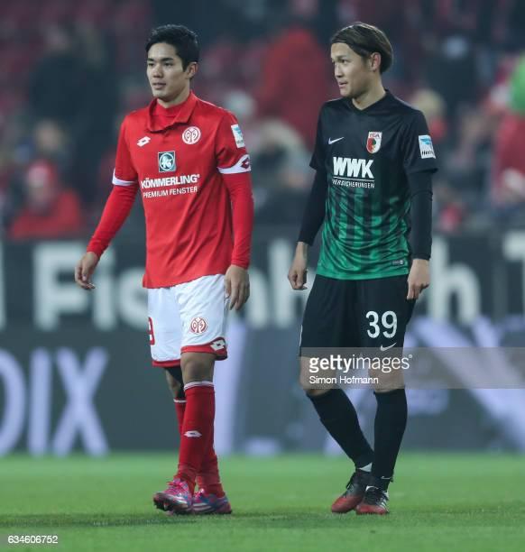 Yoshinori Muto of Mainz chats with Takashi Usami of Augsburg during the Bundesliga match between 1 FSV Mainz 05 and FC Augsburg at Opel Arena on...