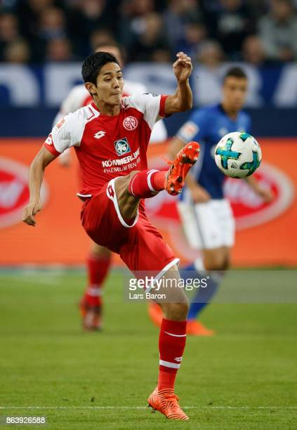 Yoshinori Muto of Mainz kicks the ball during the Bundesliga match between FC Schalke 04 and 1 FSV Mainz 05 at VeltinsArena on October 20 2017 in...