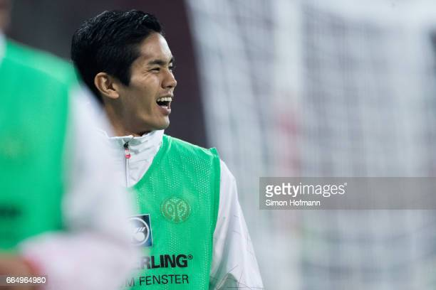 Yoshinori Muto of Mainz looks on as he warms up during the Bundesliga match between 1 FSV Mainz 05 and RB Leipzig at Opel Arena on April 5 2017 in...