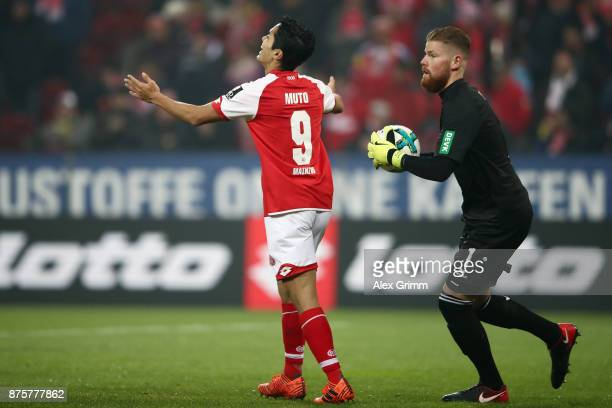 Yoshinori Muto of Mainz reacts next to goalkeeper Timo Horn of Koeln during the Bundesliga match between 1 FSV Mainz 05 and 1 FC Koeln at Opel Arena...