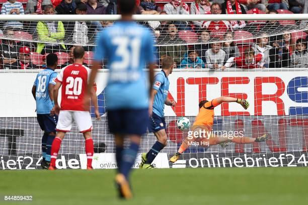 Yoshinori Muto of Mainz scored his teams first goal to make it 11 during the Bundesliga match between 1 FSV Mainz 05 and Bayer 04 Leverkusen at Opel...