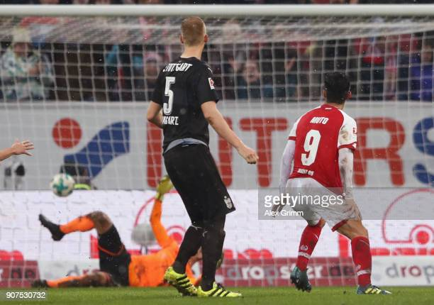 Yoshinori Muto of Mainz scores his team's first goal against Timo Baumgartl and goalkeeper RonRobert Zieler of Stuttgart during the Bundesliga match...