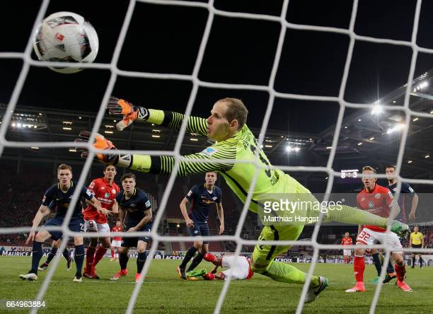 Yoshinori Muto of Mainz scores his team's second goal past goalkeeper Peter Gulacsi of Leipzig during the Bundesliga match between 1 FSV Mainz 05 and...