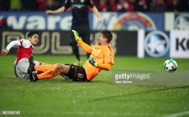 Yoshinori Muto of Mainz scores his team's second goal past goalkeeper RonRobert Zieler of Stuttgart during the Bundesliga match between 1 FSV Mainz...