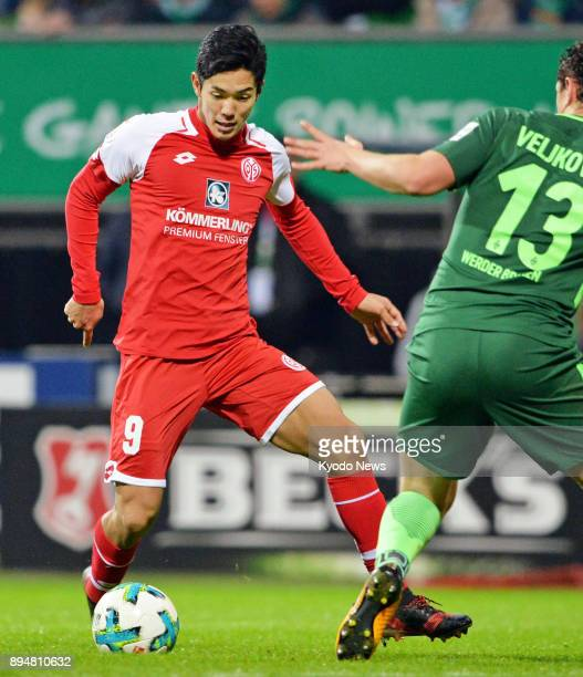 Yoshinori Muto of Mainz tries to fend off Milos Veljkovic of Werder Bremen during the second half of a German Bundesliga football match at Weser...