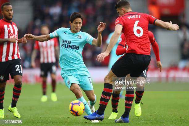 Yoshinori Muto of Newcastle faces upto Wesley Hoedt of Southampton during the Premier League match between Southampton FC and Newcastle United at St...