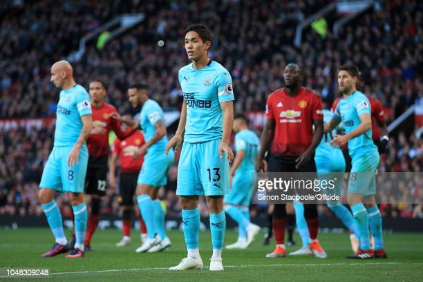 Yoshinori Muto of Newcastle looks on during the Premier League match between Manchester United and Newcastle United at Old Trafford on October 6 2018...