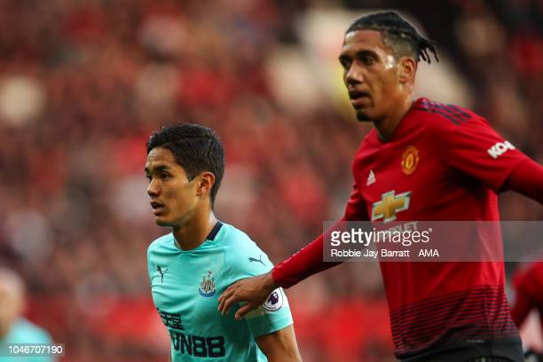 Yoshinori Muto of Newcastle United and Chris Smalling of Manchester United during the Premier League match between Manchester United and Newcastle...