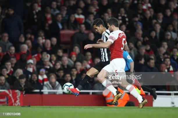 Yoshinori Muto of Newcastle United and Sokratis Papastathopoulos of Arsenal during the Premier League match between Arsenal and Newcastle United at...