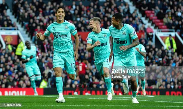 Yoshinori Muto of Newcastle United celebrates after he scores the second goal during the Premier League match between Manchester United and Newcastle...
